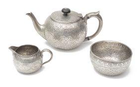 A late Victorian silver three piece bachelors tea service