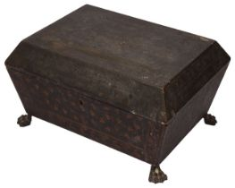A Regency gilt decorated black lacquer sarcophagus shaped work box