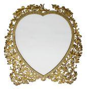 An Edwardian brass heart shaped easel back mirror