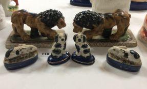 Three pairs of Staffordshire pottery animal figures,