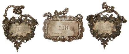 A pair of modern silver decanter labels and another
