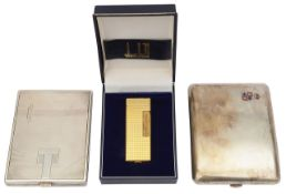 Two Austrian .900 silver cigarette cases and a cased Dunhill gold plated rollagas cigarette lighter