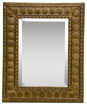 An early 20th century brass framed wall mirror,