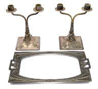 A pair of Austrian Jugendstil silver plated twin branch candelabra by Moritz Hacker