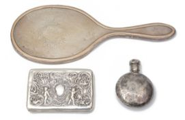 A late Victorian silver cigarette case, a George V silver hand mirror and a scent bottle