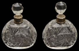 A pair of George V silver mounted cut glass scent bottles,