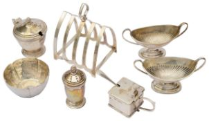 A George VI silver arched four division toast rack; others