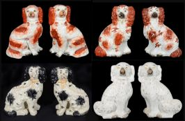 Four pairs of 19th century and later Staffordshire pottery dogs,