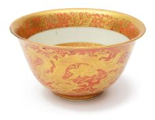 A Chinese porcelain coral ground and gilt decorated 'Kinrande' style deep bowl