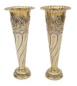 A pair of Edwardian silver-gilt spill vases