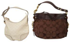 A Gucci light beige monogrammed shoulder bag and a Coach brown leather shoulder bag