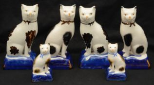 Three pairs of 20th century Staffordshire pottery cats,
