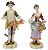 A pair of Volkstedt porcelain figures of flowers sellers