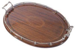 Tiffany & Co. A silver galleried oval mahogany drinks tray