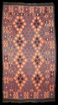 A Kelim rug red ground with a field of diamonds