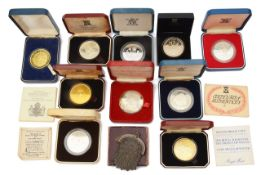 A collection of mostly silver proof crowns and other coins