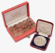 An Austrian cased set of 25 schilling coins and a cased .950 silver prize medal