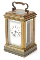 An early 20th century brass miniature carriage clock
