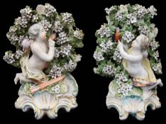 A near pair of late 18th century Derby figural bocage candlesticks