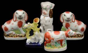 A group of 19th century and later Staffordshire pottery animals,