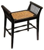 An Arts and Crafts ebonised beechwood stool in the style of Morris & Co