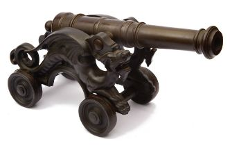 A late 19th century patinated bronze table cannon