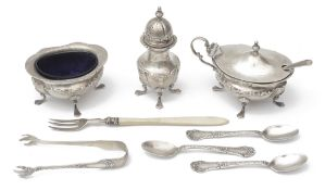 An Edwardian silver three piece cruet set and other silver items
