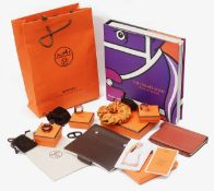 A collection of Hermes accessories