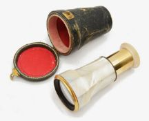 A 19th century French brass and mother of pearl monocular,