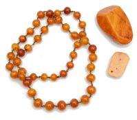 A large irregular polished piece of butterscotch amber