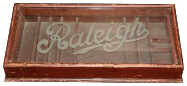 A vintage Raleigh Cycles wooden display cabinet,