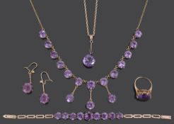 An Edwardian amethyst set drop necklace and a matched suite of similar jewellery