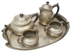 A Liberty & Co 'Tudric' hammered pewter five piece tea service Attrib. to Archibald Knox c.1905