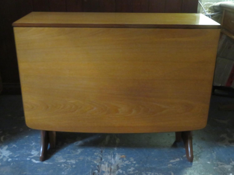G Plan mid 20th century teak drop leaf dining table. Approx. 74cms H x 90.5cms W x 136cms D