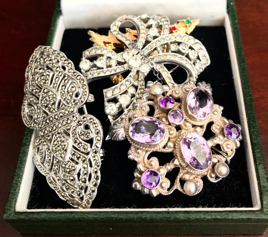 Four various costume brooches