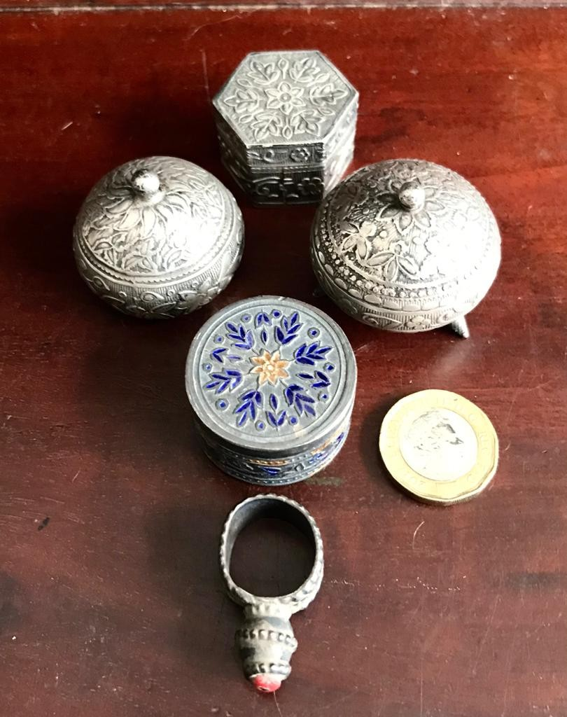 FIVE EASTERN SILVER COLOURED METAL ITEMS- FOUR PILL BOXES AND RING, POSSIBLY CORAL SET, GROSS WEIGHT