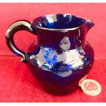 EARLY BRISTOL BLUE GLASS CREAM JUG, APPROXIMATELY 8cm HIGH