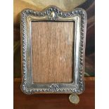 SILVER REPOUSSE PHOTOGRAPH FRAME WITH GLASS, BIRMINGHAM 1908, GLASS SIZE APPROXIMATELY 14 x 9.5cm