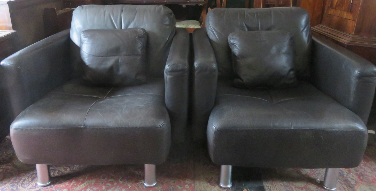 Pair of 20th century David Paine Associates Leather upholstered armchairs with chrome coloured