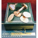Two pairs of 9ct gold cufflinks, one set with mother of pearl. Gross weight Approx. 17.6g