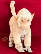 OLD PLUSH STEIFF MONKEY WITH FELT FACE AND HANDS AND FEET, GREEN AND BLACK GLASS EYES, APPROXIMATELY