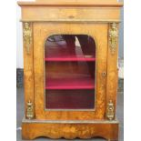 19th century walnut veneered single door glazed pier cabinet, highly decorated with marquetry