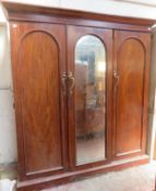 Victorian mahogany triple combination wardrobe, fitted with central mirrored door. Approximately.