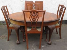 Early 20th century piecrust edged mahogany wind out extending dining table with two leaves, and four