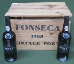 Wooden crate containing Twelve unopened bottles of Fonseca Guimaraens 1985 vintage port