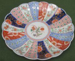 Oriental wave edged ceramic charger, decorated in the Imari palette. App. 31cm Diameter