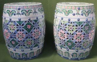 Two similar Oriental handpainted and piercework decorated ceramic barrel form window seats.