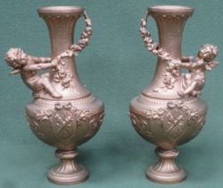 Pair of Victorian heavily gilded cast metal vases, with relief decorated cherubs and floral swags.