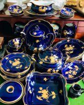 FINE JLMENAUGRAF VON HENNEBERG PORZELLAN- PORCELAIN COBALT BLUE AND RAISED GILDING DINNER SERVICE OF
