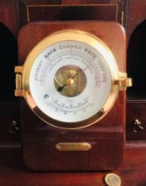 CONTEMPORARY CIRCULAR BAROMETER, DIAL APPROXIMATELY 9cm, UPON PLINTH, APPROXIMATELY 22 x 16cm